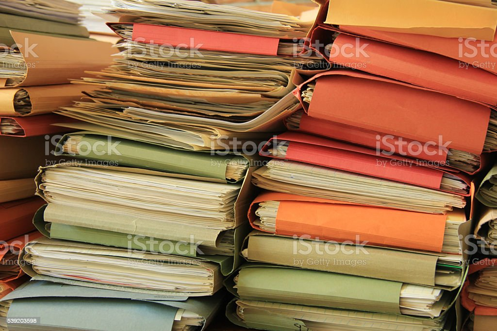 Pile of files Stacked office files: pile of paperwork in an office Bureaucracy Stock Photo