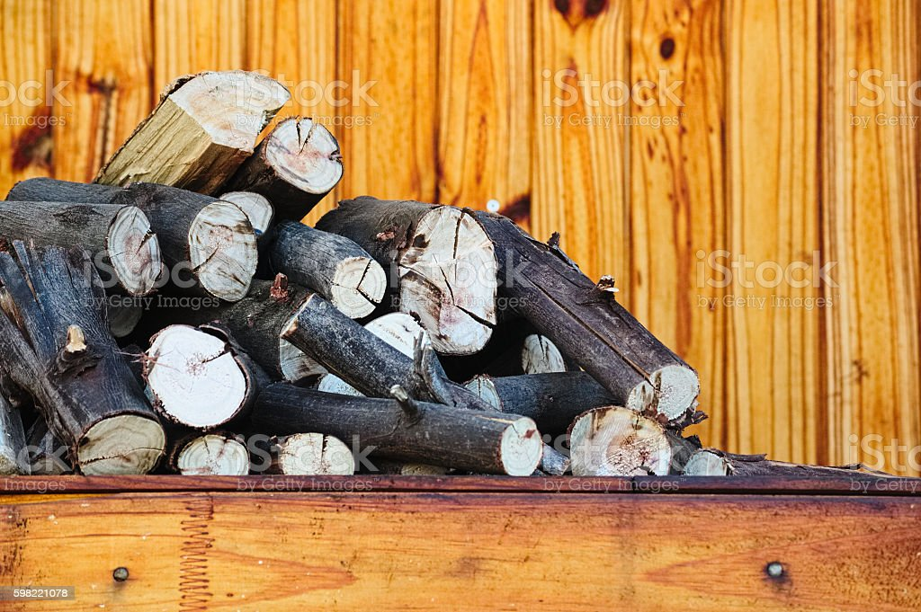 Pile of firewood on a partio make with pine planks foto royalty-free