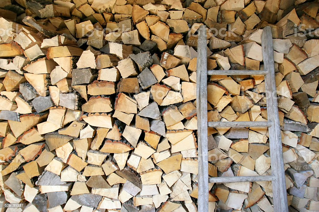 Pile of firewood store in shed stock photo