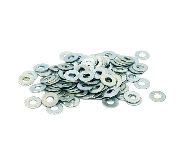 Pile of flat washers on white background Pile of flat washers on white background washer fastener stock pictures, royalty-free photos & images