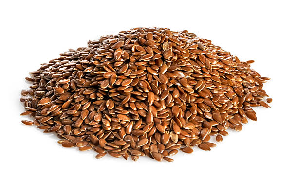 Pile of flax seed isolated on white Small pile of Flax Seed or lindseed on white background with natural shadow. See other varieties of grains in my FOOD ISOLATED  lightbox. burwellphotography stock pictures, royalty-free photos & images