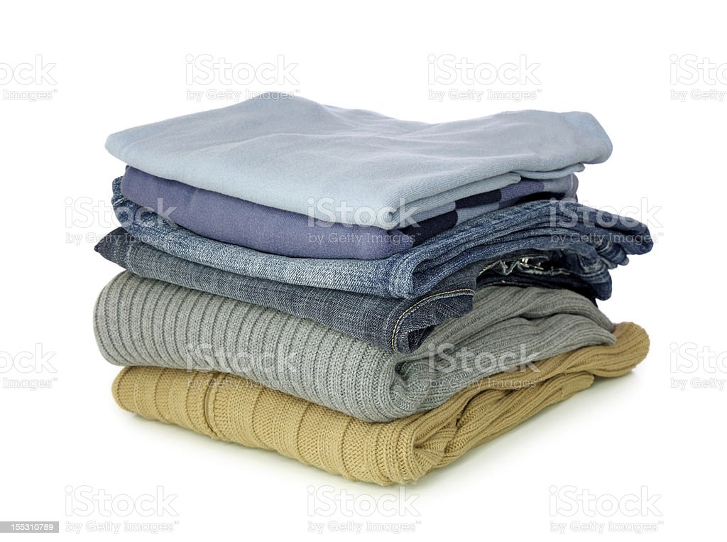 Pile of folded clothes on a white background stock photo