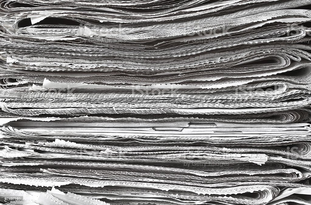 Pile of folded newspapers royalty-free stock photo