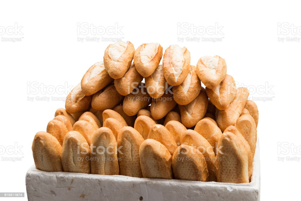 Pile of French baguette bread isolated in white background stock photo