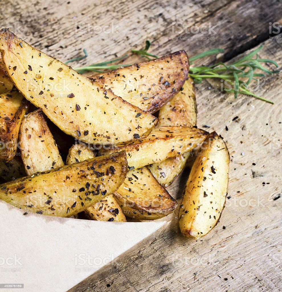 pile of French fries with herbs and spices royalty-free stock photo