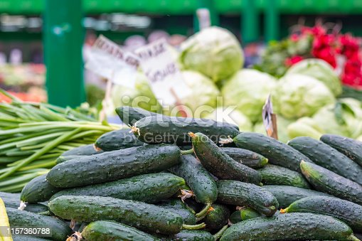 istock Pile of fresh and wet cucumber on the marketplace counter in Belgrade. Close up. 1157360788