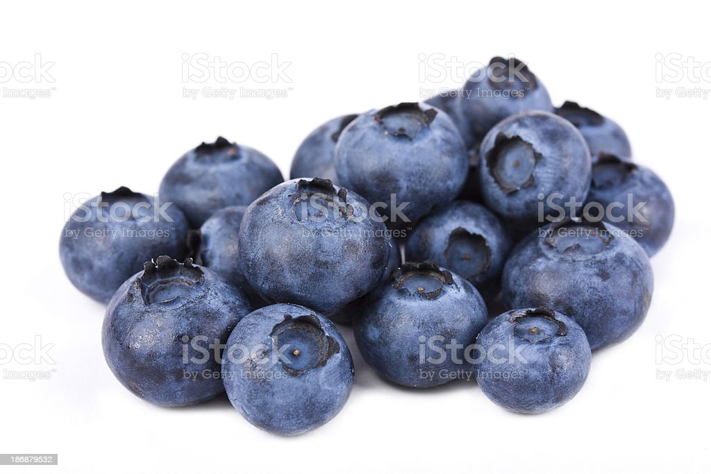 Pile of fresh blueberries on white stock photo