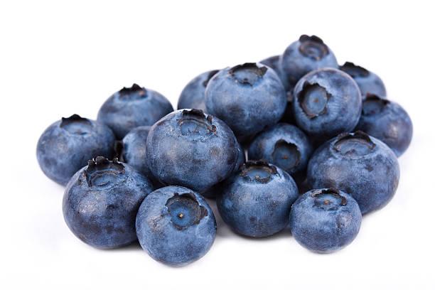pile of fresh blueberries on white - blåbär bildbanksfoton och bilder
