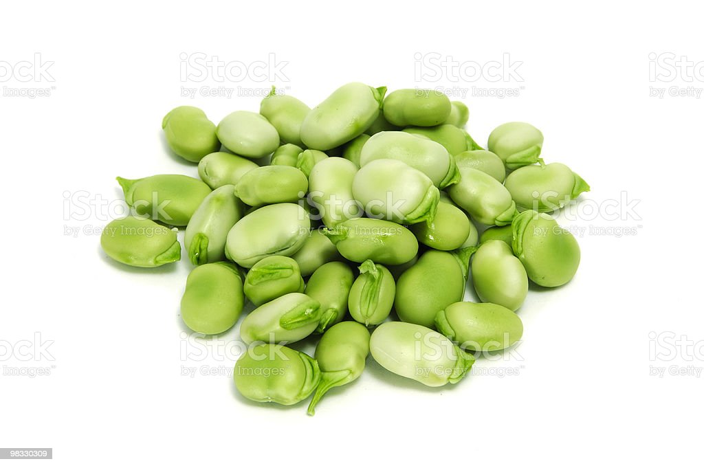 A pile of fresh green shelled broad beans isolated on white stock photo
