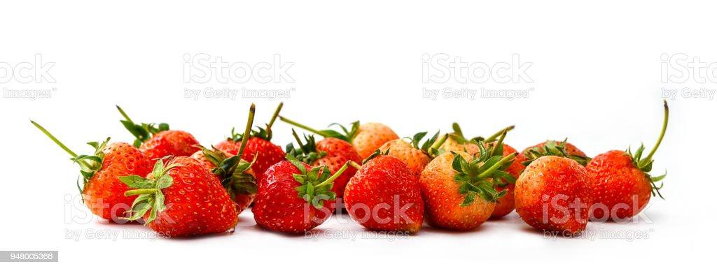 Pile of fresh strawberry isolated on white background stock photo