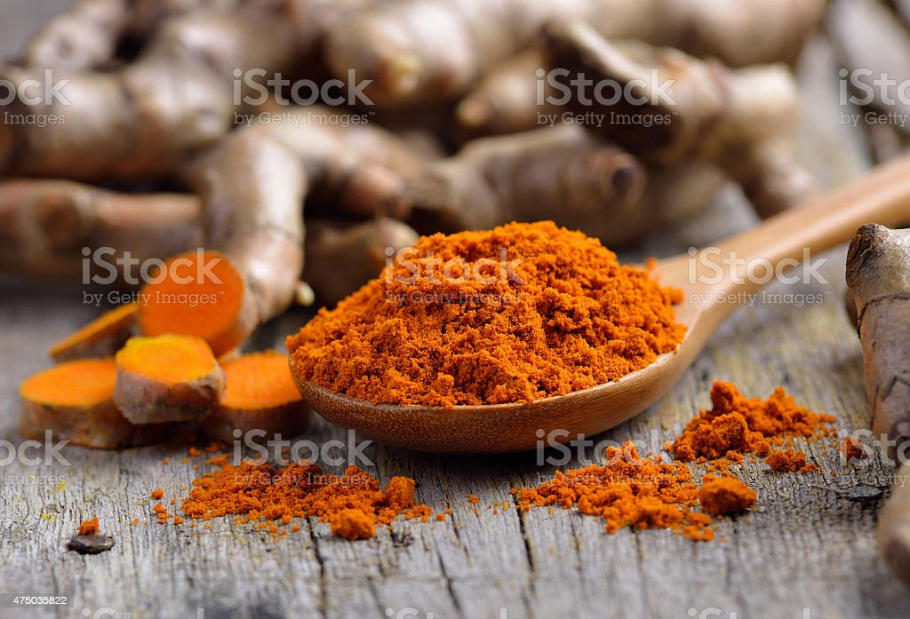 pile of fresh turmeric roots on wooden table pile of fresh turmeric roots on wooden table 2015 Stock Photo