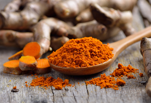 Pile Of Fresh Turmeric Roots On Wooden Table Stock Photo - Download Image Now