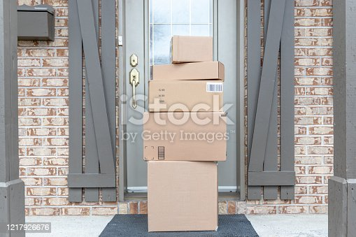 Pile of Freshly delivered Boxes being left outside at front door