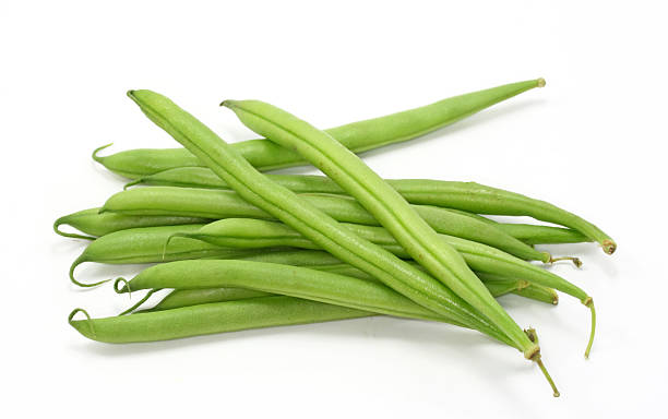 Pile of freshly picked green beans Green beans on white background plant pod stock pictures, royalty-free photos & images
