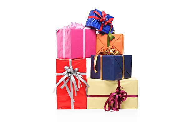 pile of gift boxes in various sizes and colors - birthday gift stock photos and pictures