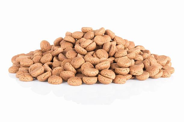 pile of ginger nuts. typical dutch candy for sinterklaas event - kruidnoten stockfoto's en -beelden