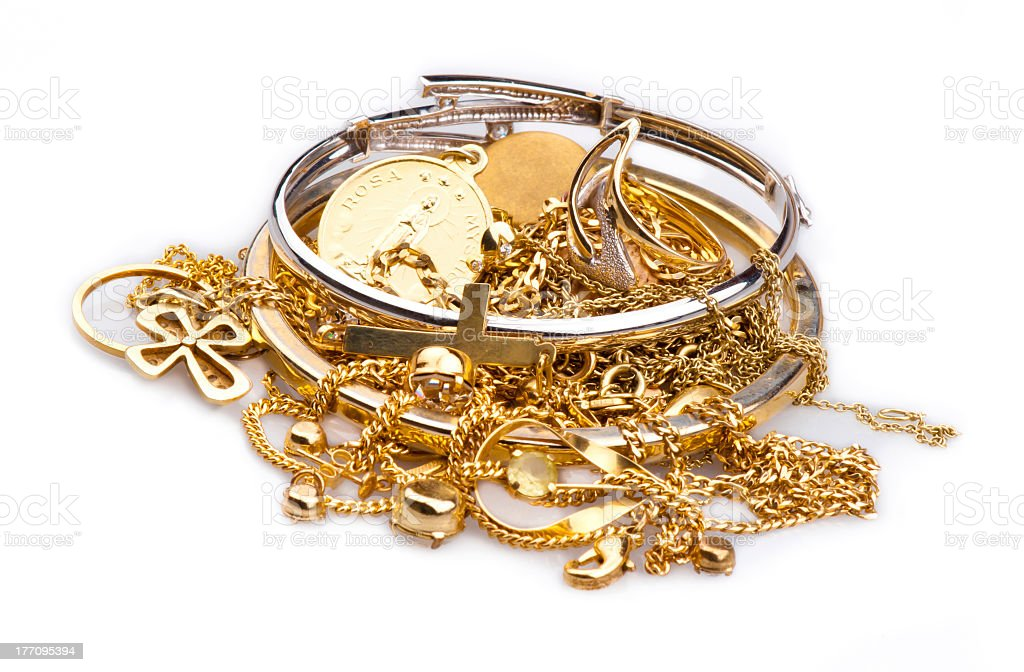 A pile of gold and silver scrap jewelry on white stock photo