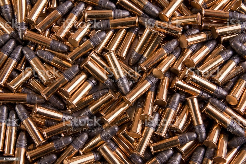 Pile of gold bulk 22 caliber ammo stock photo