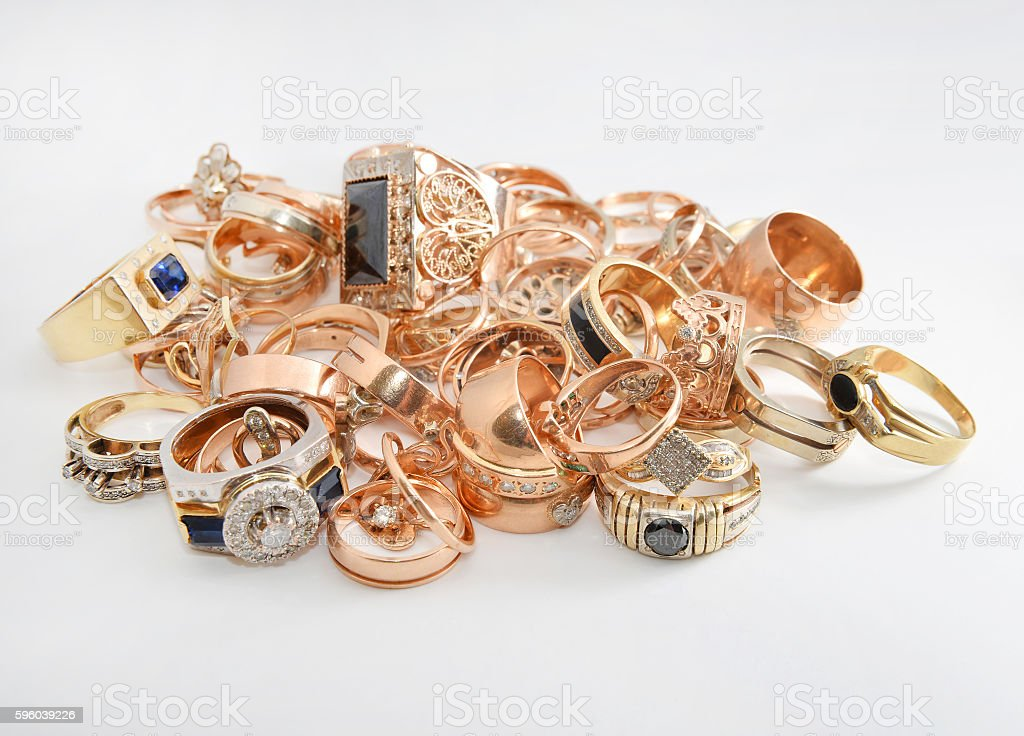 pile of gold on a white backgrou stock photo