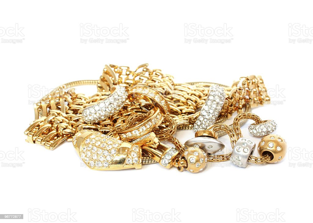 Pile of gold, silver, and diamond chain link jewelry royalty-free stock photo