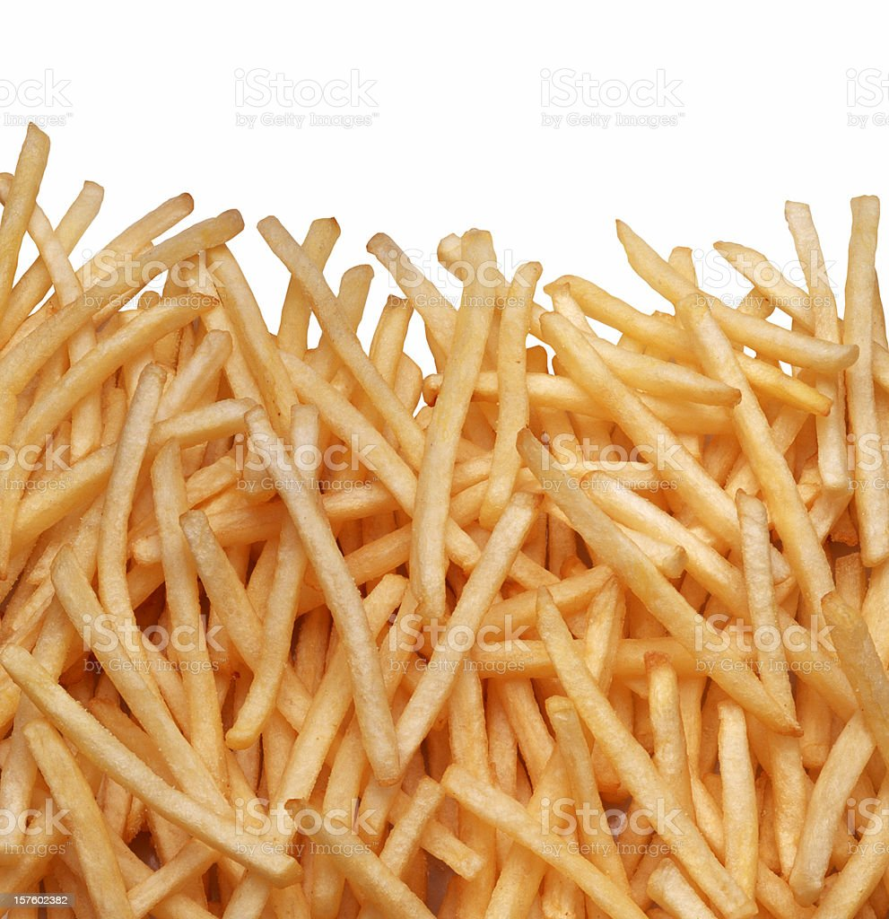 A pile of golden, normal cut French fries stock photo