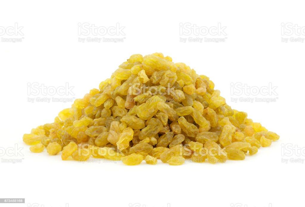 pile of golden raisins on white background stock photo