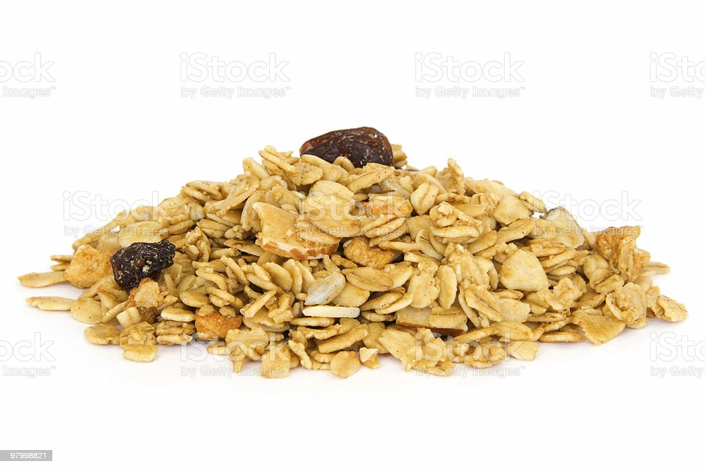 Pile of granola cereal on white royalty-free stock photo