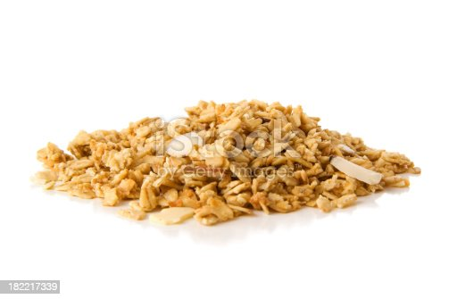 Pile of granola cereal with almonds isolated on white background. Please see my LIGHTBOXES for additional related images: