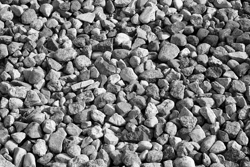 istock Pile of gravel stones in black and white. 869250360
