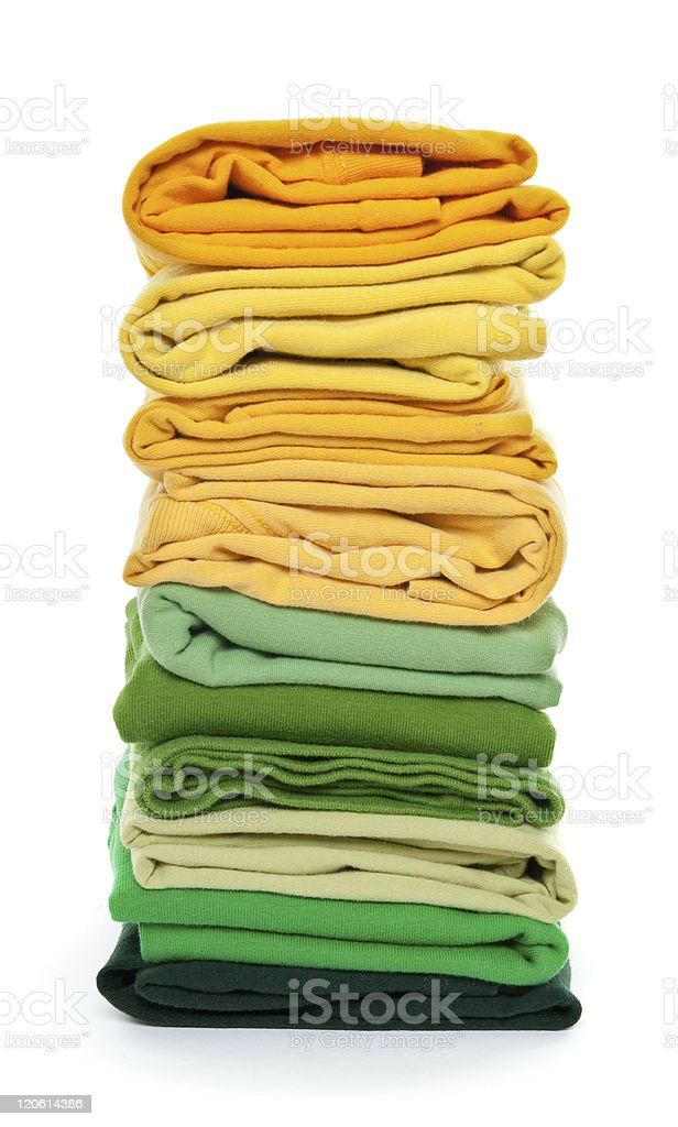 Pile of green and yellow folded clothes royalty-free stock photo