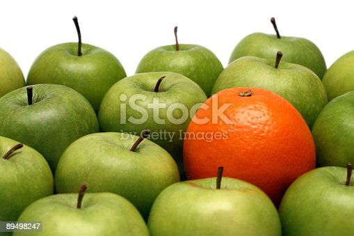 istock A pile of green apples and one orange 89498247
