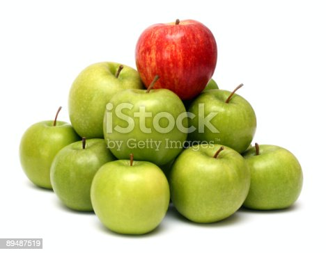 istock A pile of green apples with a red apple on top 89487519