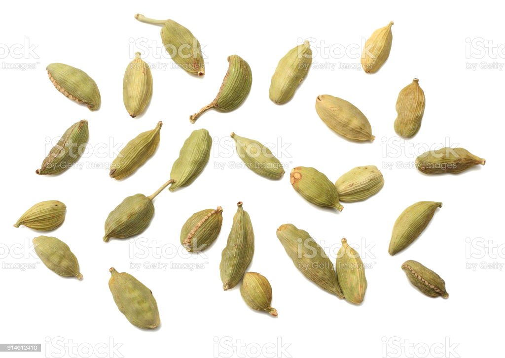 Pile of green Cardamom, cardamon or cardamum (dried fruits of Elettaria cardamomum) isolated on white. shadow separated top view stock photo