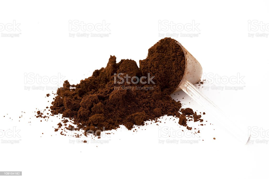 Pile of ground coffee and a measuring spoon stock photo