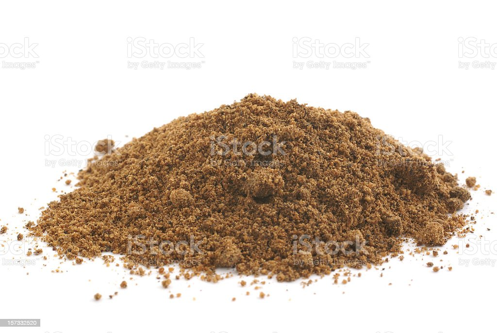 pile of ground nutmeg stock photo