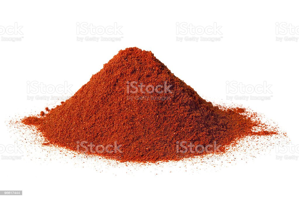 A pile of ground paprika on a white background stock photo