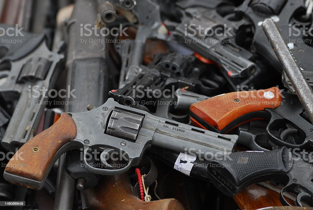 pile of guns stock photo