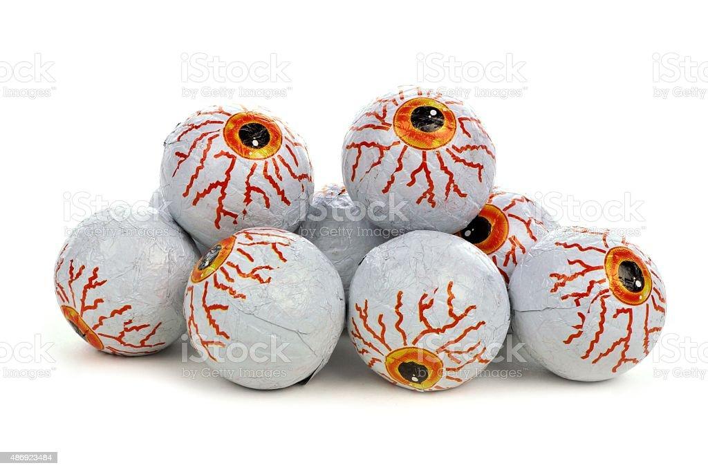 Pile of Halloween candy eyeballs over white stock photo