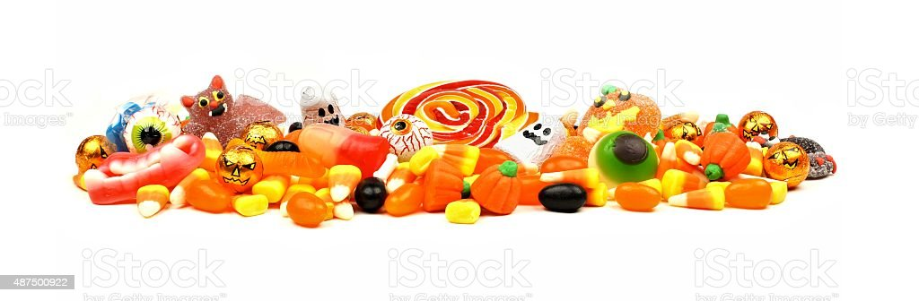 Pile of Halloween candy over white stock photo
