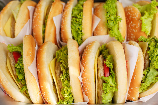 Pile of hamburgers on a tray, ready to be served at the fast food stock photo