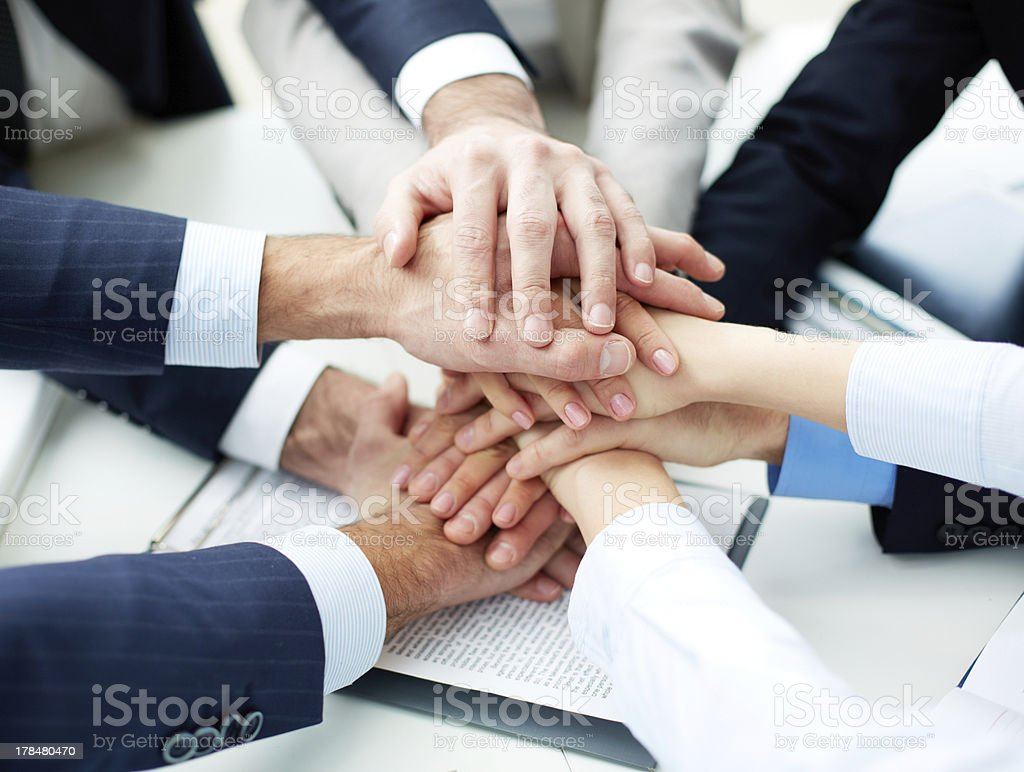 Pile of hands stock photo