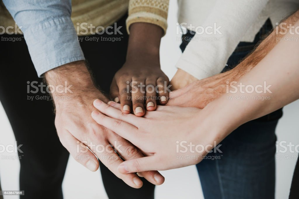 Pile of hands unity teamwork diverse people stock photo