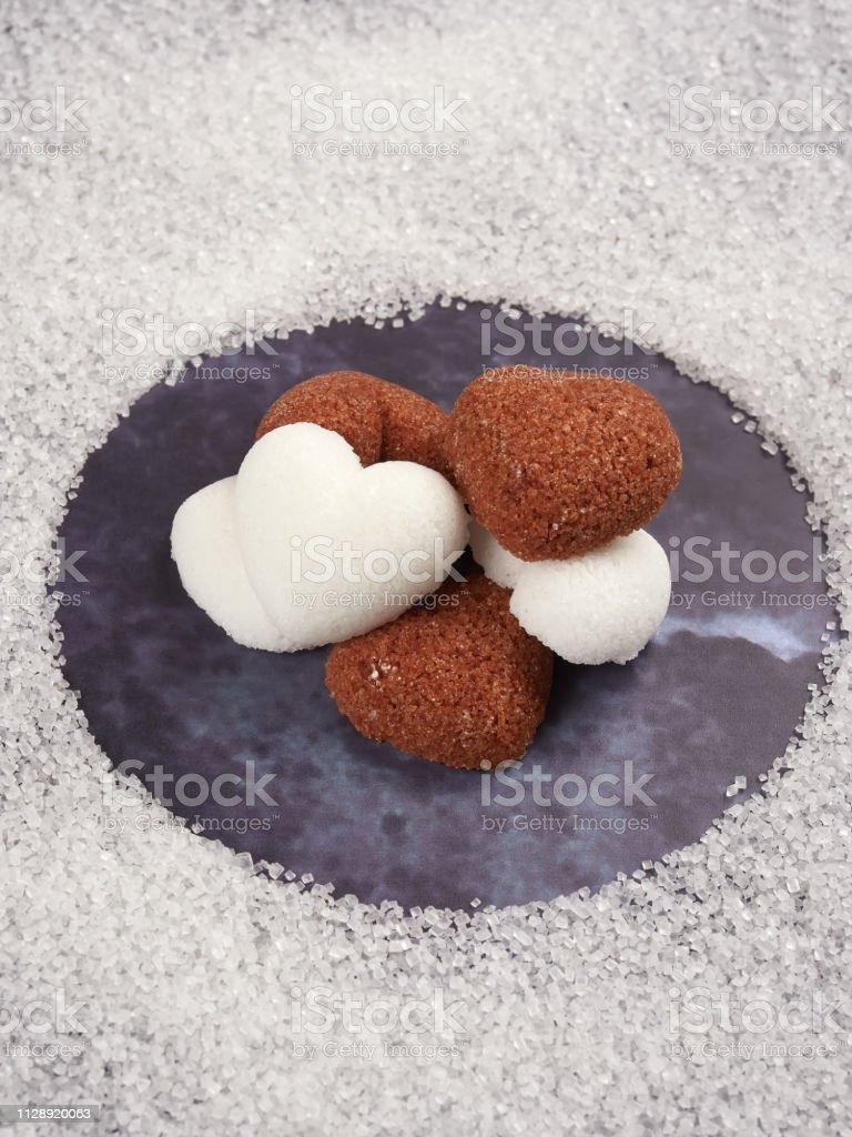 A pile of heart shaped sugar cubes stock photo