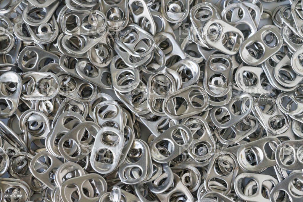 Pile of hoop can opener or pull ring as recycle, reuse again or green world concept stock photo