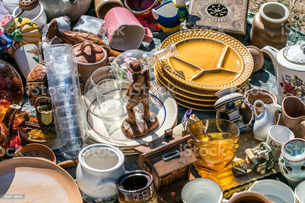 pile of household things and decorative objects at welfare stock photo