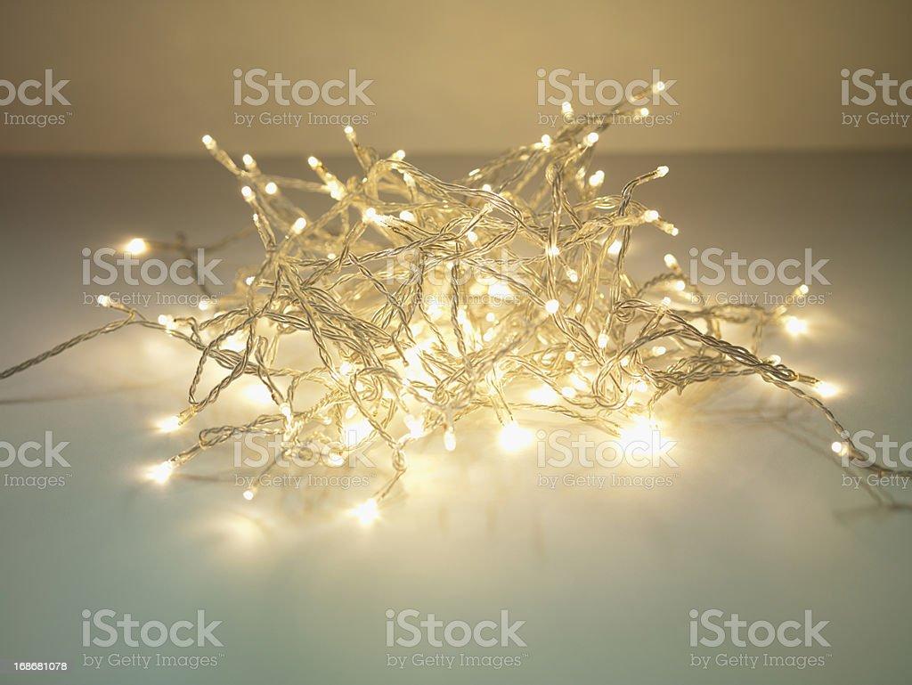 Pile of illuminated string lights stock photo