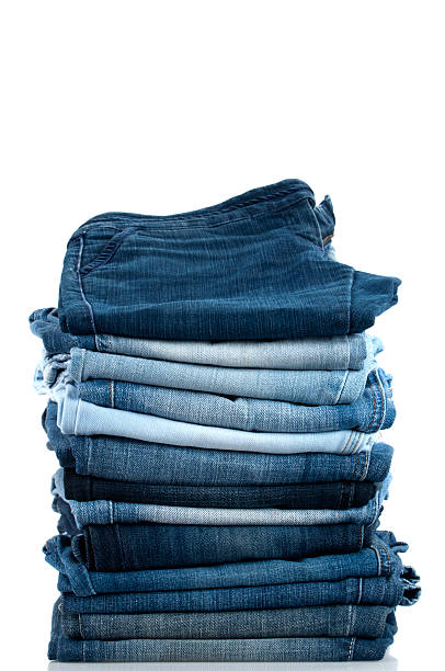 pile of jeans - jeans stock photos and pictures