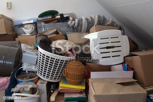 Pile of junk in a house, hoarder room pile of household equipment needs clearing out storage