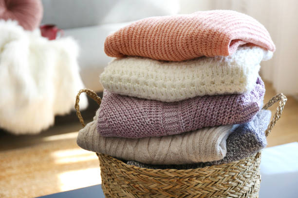 pile of knitted sweaters of different colors and patterns perfectly stacked. - caxemira imagens e fotografias de stock