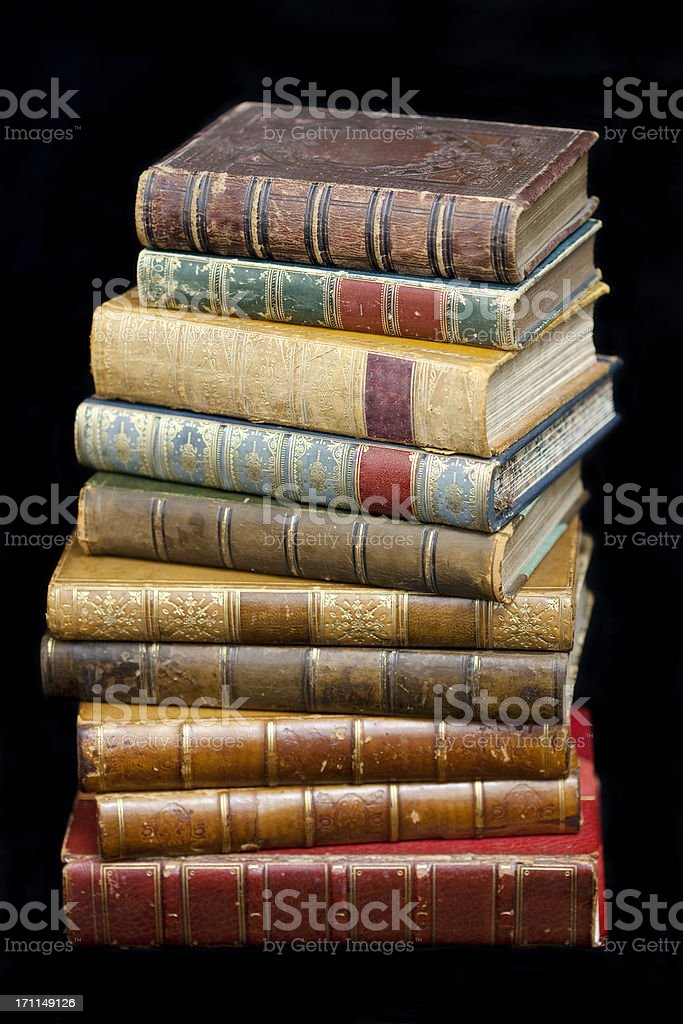 Pile of Leather Bound Antique Books royalty-free stock photo